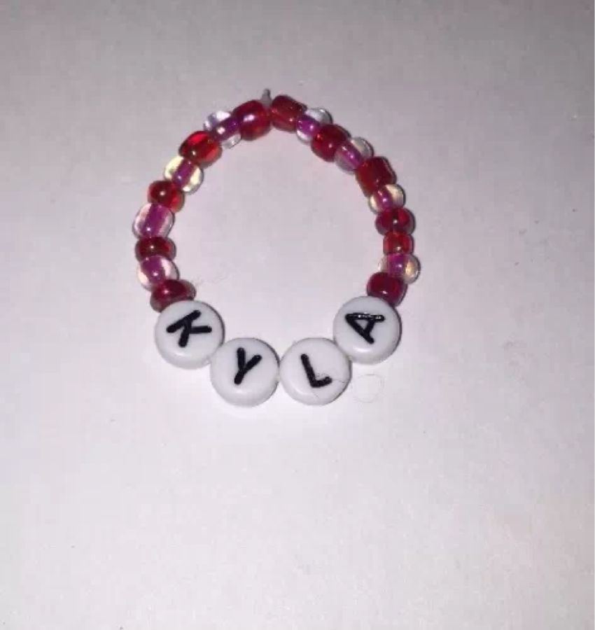 Chatty Cathy ID bracelet black and white letters and white pearls