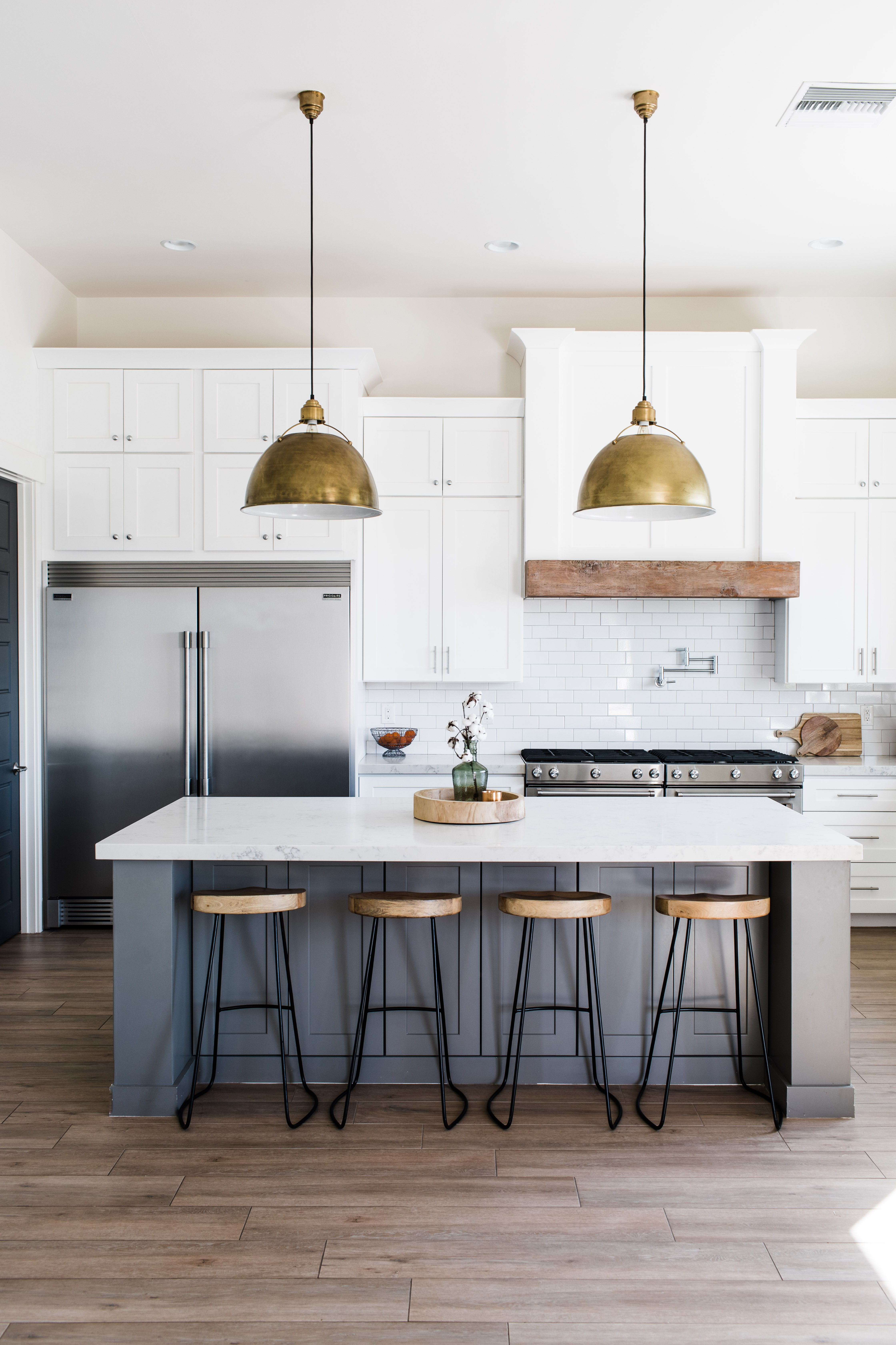 White And Blue Kitchen With Gold Pendant Lights From Phoenix Home Builder White Kitchen Decor Kitchen Style Gold Pendant Lighting