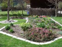 """Marcia Sofonoff won a one-hundred dollar Shopping Spree in our eStore with her """"Runner-Up"""" Garden Edging Project prize winner. She poured hundreds of these thick garden edging stones using concrete and our  #7000 Garden Edging Mold Kit...saving herself thousands of dollars."""