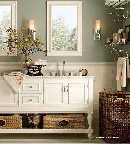 Love the mix of neutrals, whites, and chrome in this bathrom. Clean and classy, great table vignette .