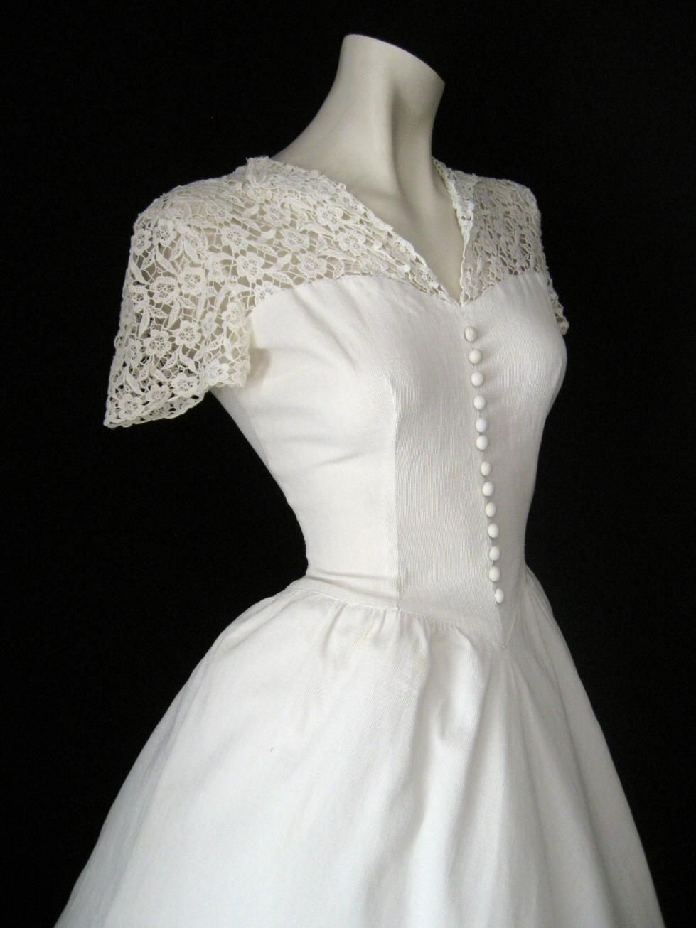 1940s Wedding DresA.D. Love the lace and button detail down the ...