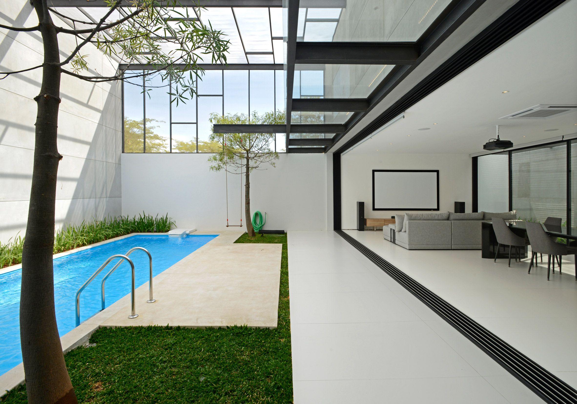 Parallel Concrete Walls Divide Up Jj House By Ivan Priatman Architecture Concrete Wall Internal Courtyard