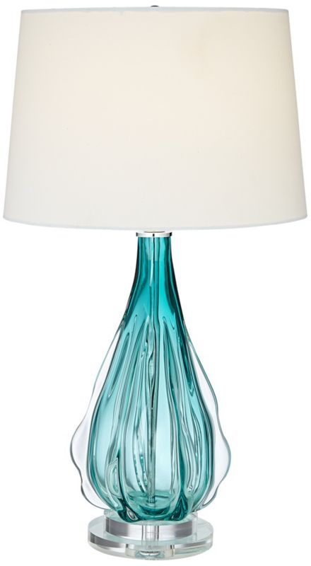 Contemporary In Style, This Eclectic Table Lamp Adds A Touch Of Brightness  To Any Room. Made Of Wavy Turquoise Colored Glass For An Eye Catching Design .