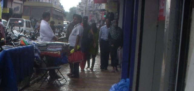 Footpaths occupied by hawkers — at Laxmi Road.