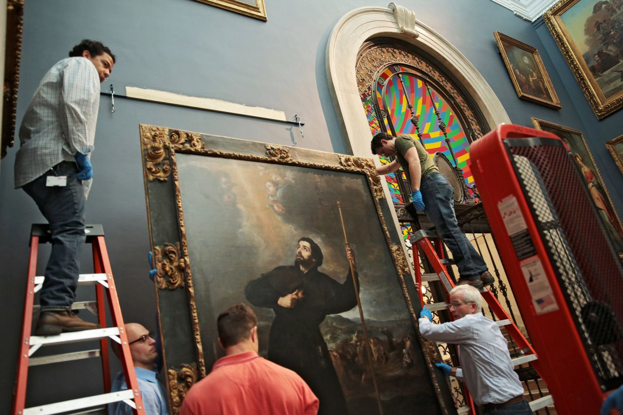"""Hanging Murillo's painting of St. Francis Xavier in the Great Hall."" (NYTimes) [Wadsworth Atheneum]"