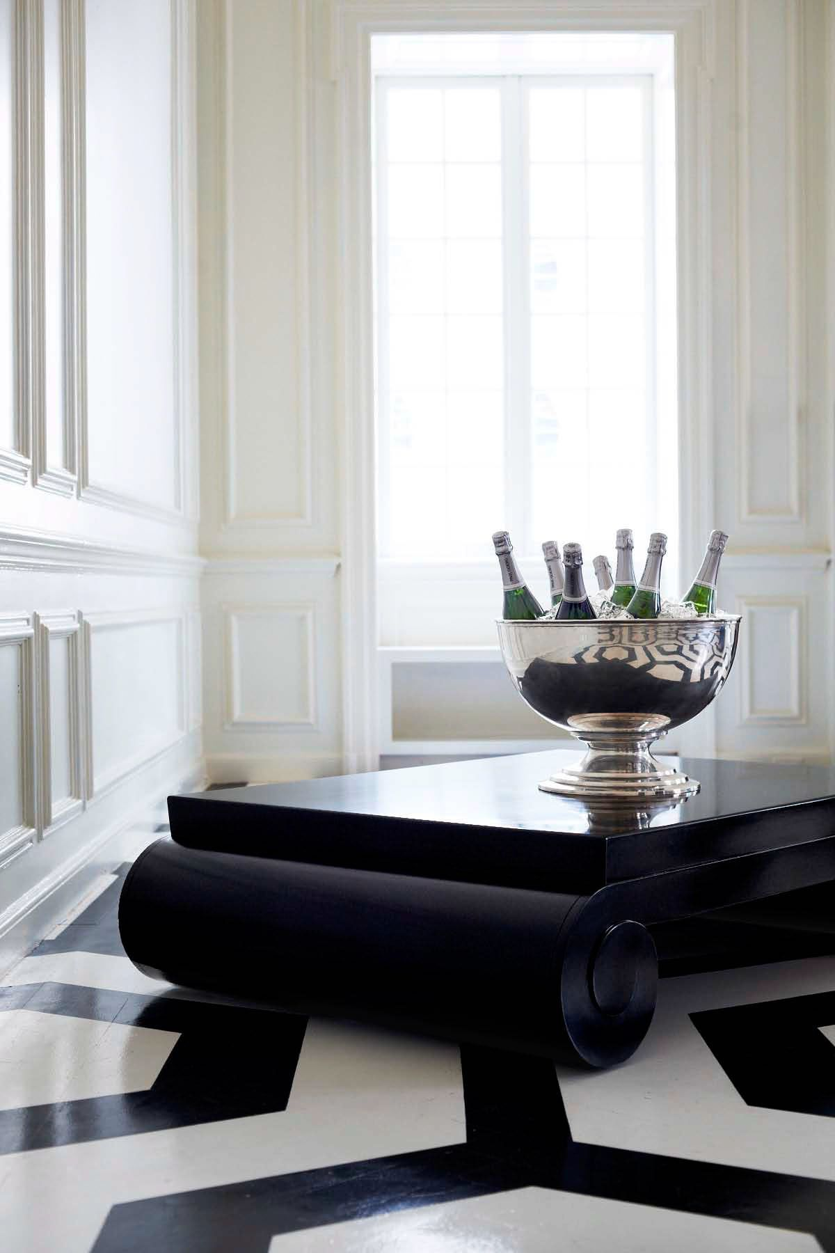 Ralph Lauren Homeu0027s Brook Street Cocktail Table, A Low, Black Coffee Table  With Dramatically Scaled Pillar Legs