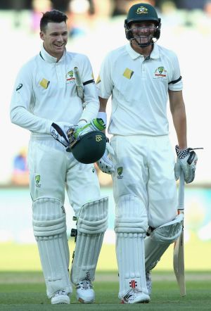 All smiles: Peter Handscomb, left, and Renshaw walk off the Adelaide Oval after claiming victory. Photo: Getty Images
