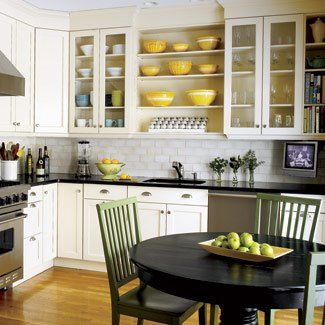 White subway tile backspalsh, open shelving, and bright accent color.