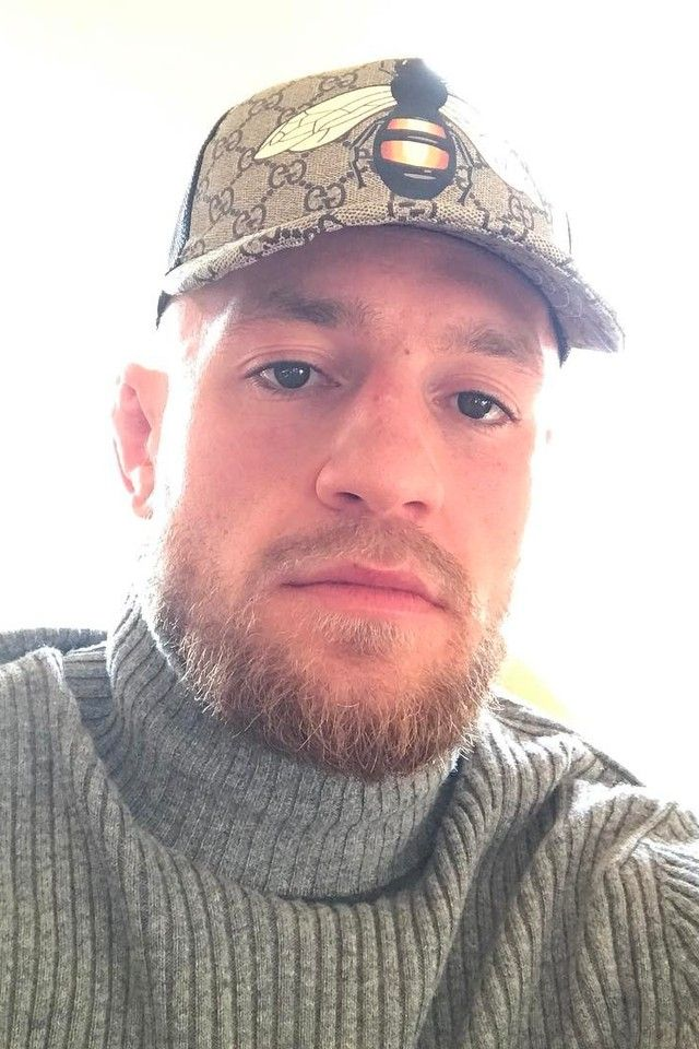 94eb16db66569 Conor McGregor wearing Gucci Bee print GG Supreme baseball hat