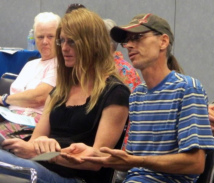 Sterling Stuhldryer (center) asks a question of the representatives from Alliant Energy/IPL during a customer comment meeting on Tuesday night at Clinton Community College. Stuhldryer was one of two customers to ask a question. Katie Dahlstrom/Clinton Herald