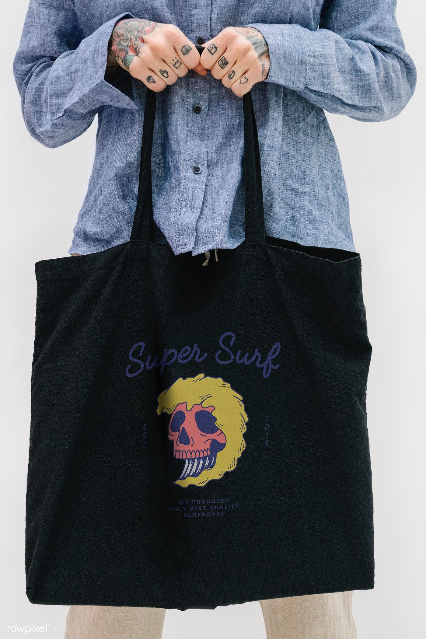 Download Download Premium Psd Of Tattooed Woman In A Blue Linen Shirt Holding A Linen Shirt Black Tote Bag Blue Linens