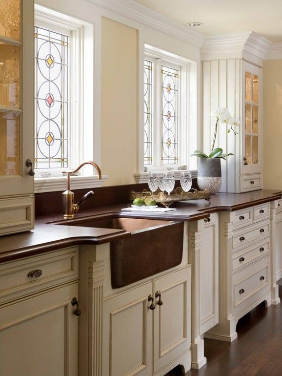 Leaded glass above kitchen sink. Excellent idea to hide the view ...
