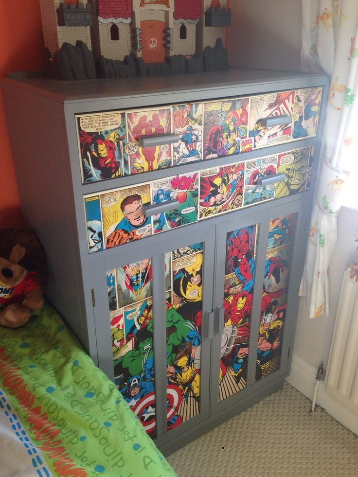 Old wooden tallboy painted grey with marvel comic strip decoupage applied to draw fronts and doors perfect for boys room done something just like this