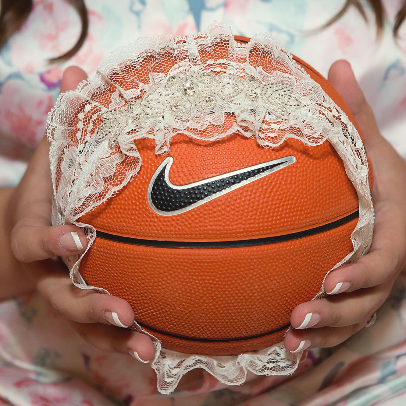 My husband loved that he got to toss a mini basketball for the garter toss  at our wedding!   Sports themed wedding, Basketball wedding, Sports wedding