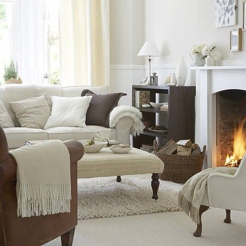 White Cosy Living Room With Carpeted Floor Ca Rpet Sofa Brown Leather Couch Fireplace Cabinet And Decorations Picture On VisualizeUs