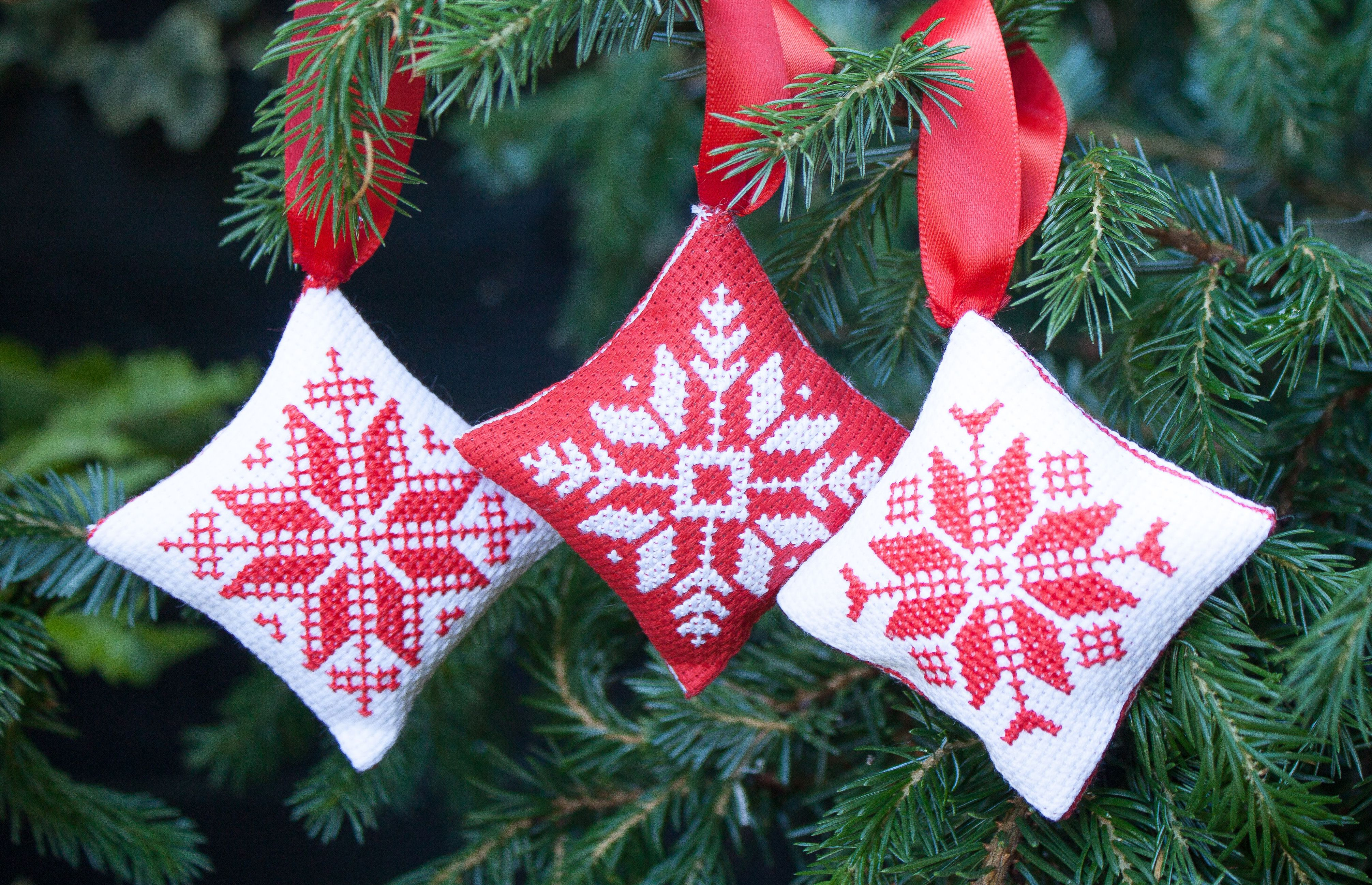 Make your own Christmas Cross stitch baubles. Simple designs in a Nordic style.