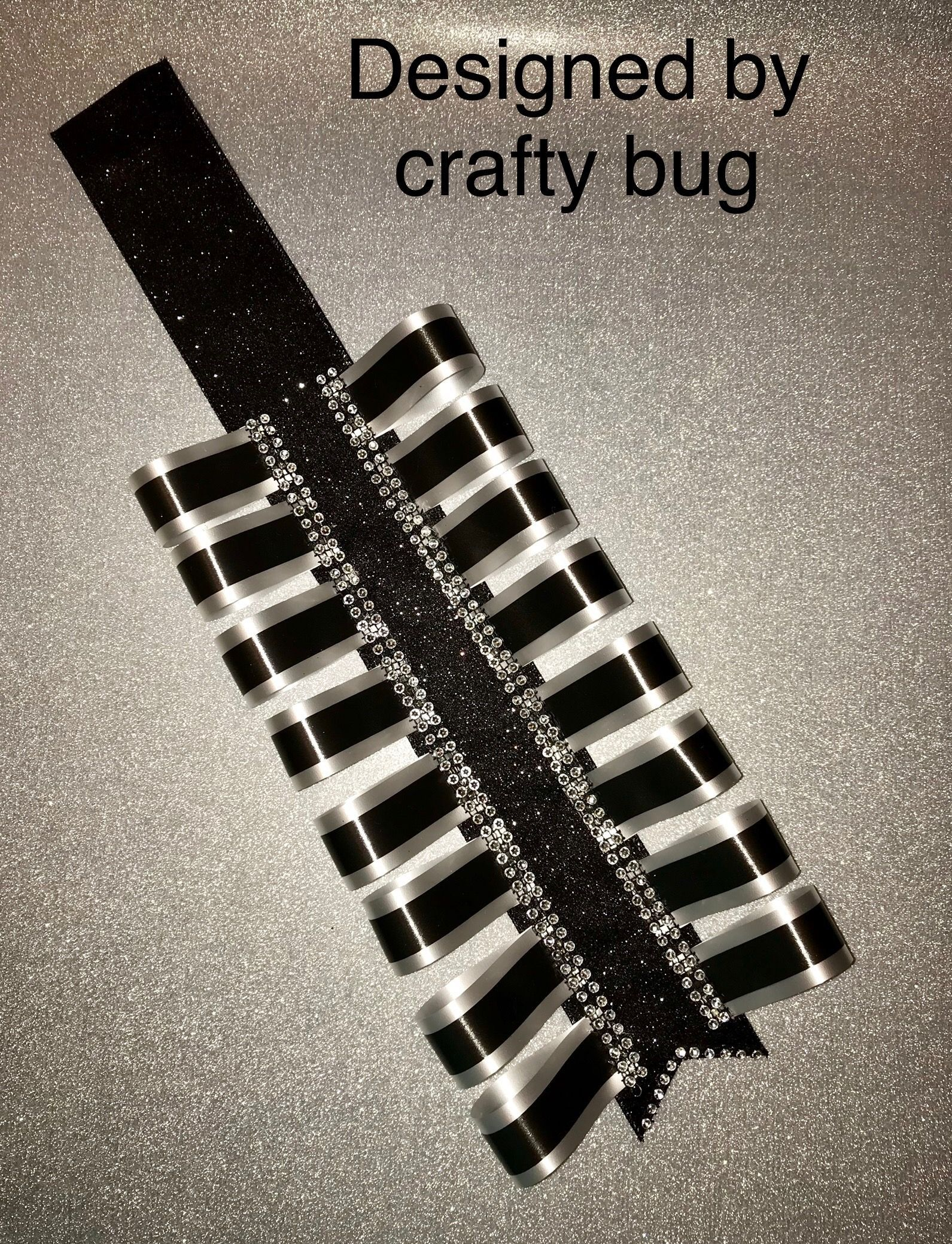 Black and white homecoming mum double loopy braid for homecoming mum. Designed by crafty bug #homecomingmumsdiy Black and white homecoming mum double loopy braid for homecoming mum. Designed by crafty bug #homecomingmumsdiy