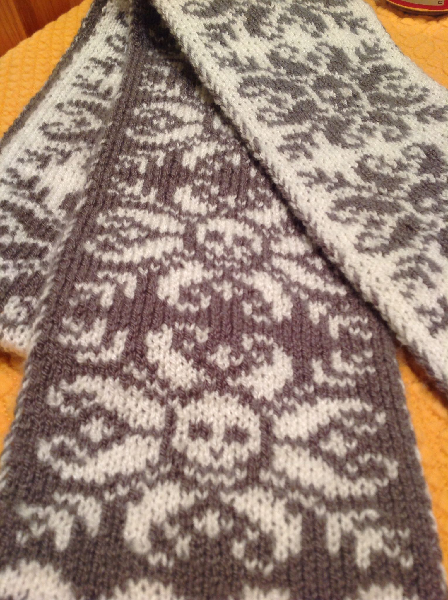 Double sided knitted skull scarf in charcoal and cream. Pattern is ...
