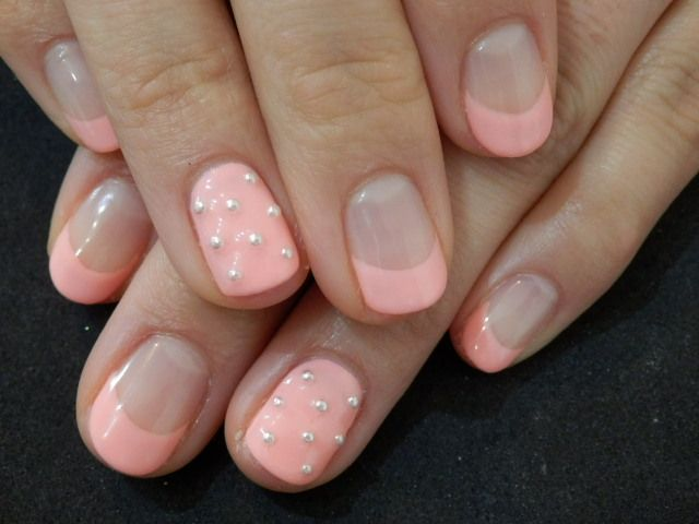 French tip nails with matching solid accent nail with pearls. To ...