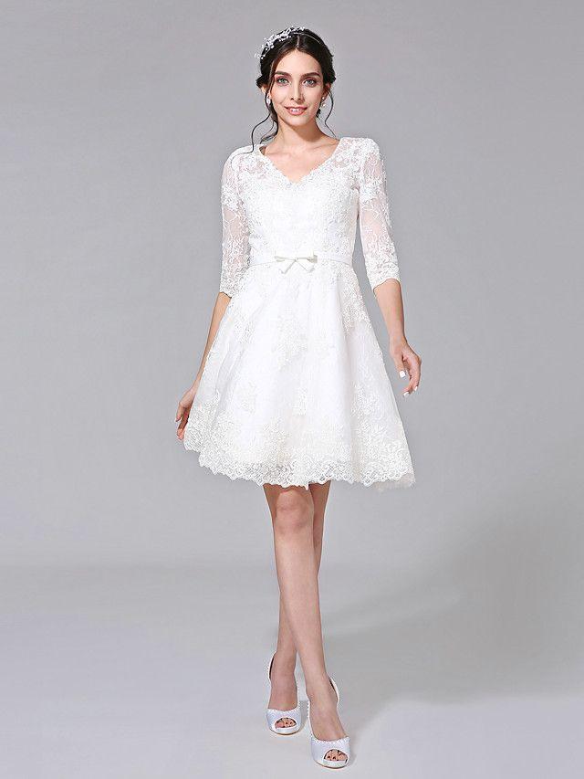 Vestidos blancos de encaje ala rodilla