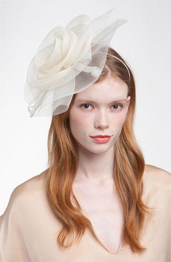 Tasha  Flower Fascinator  Headband A dramatic tulle rose swirls atop an  etheral fascinator headband. Approx. flower diameter  12