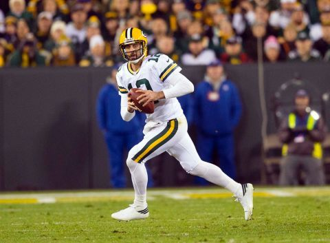 huge discount 52717 5e288 Aaron Rodgers in the Green Bay Packers all-white color rush ...