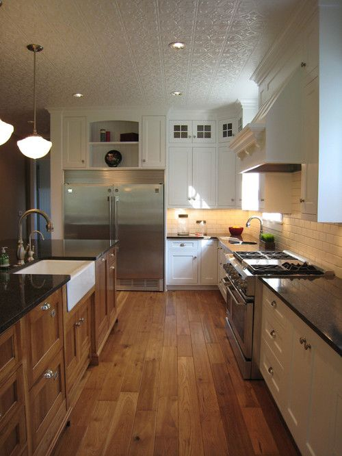Warm Wood Flooring White Cabinetry Stainless Appliances