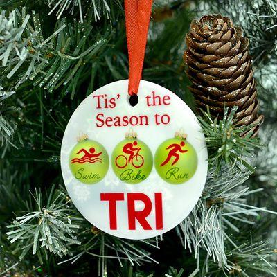 Triathletes will love this original Milestones' designed Christmas ornament  featuring holiday Swim, Bike, Run Christmas ball ornaments & the saying