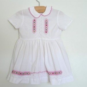pink stitch c. 1945 white cotton dress finished with lace inserts + pink embroidery detail. 4 buttons in back.