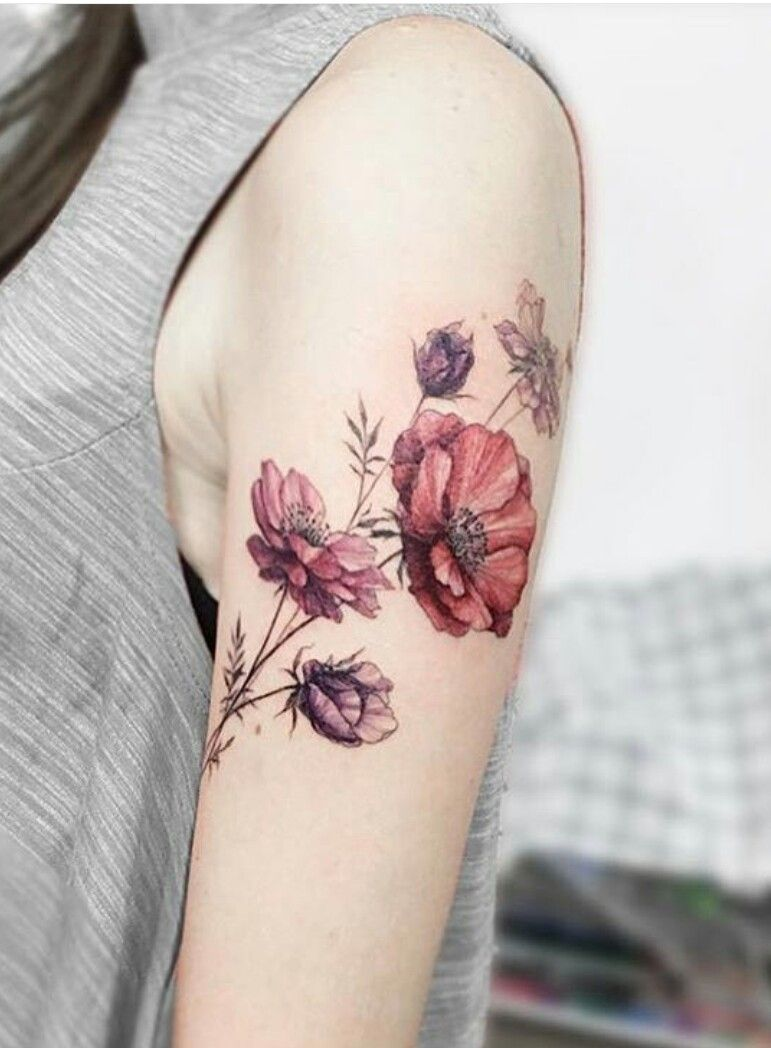 Stunning poppy floral tattoo design arm placement vintage colour