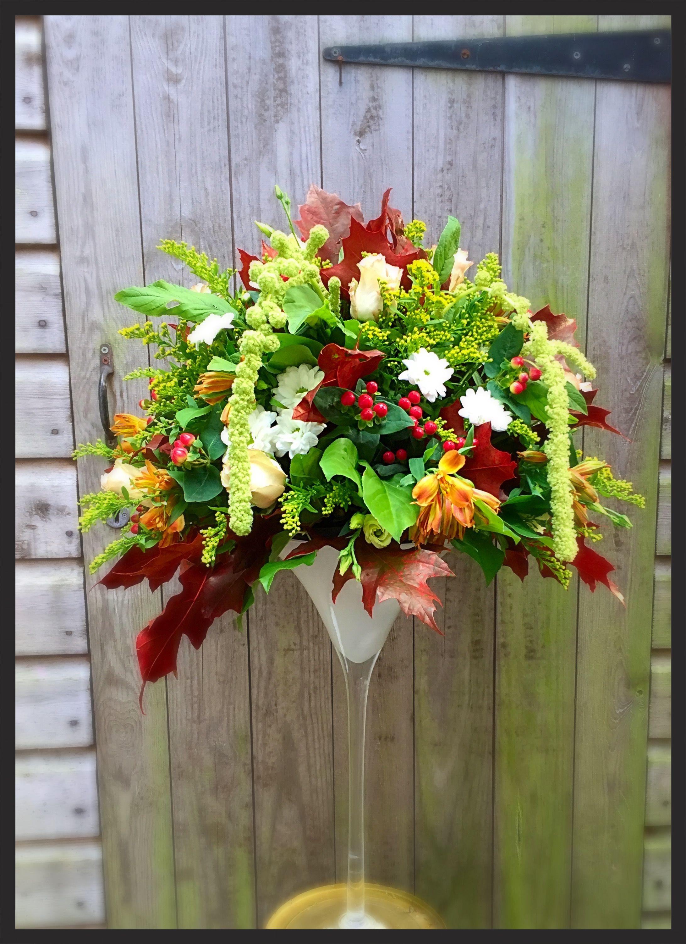 Autumnal tall table arrangement