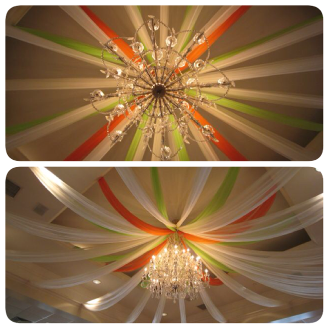Green and orange mixed with the classic white drapery to really make this space pop!