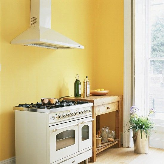 Yellow kitchen with range cooker and butcher\'s table | Kitchen ...
