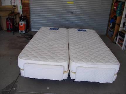 adjustable split queen beds, remote controls (plega).   beds