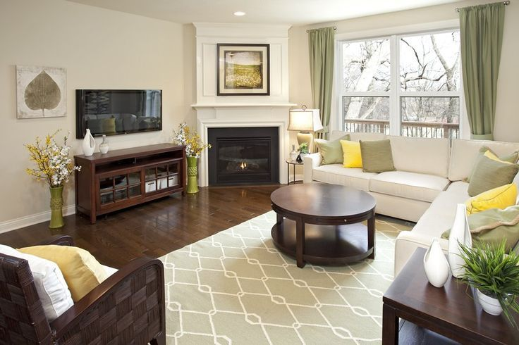 Corner fireplace furniture placement in living room with for Tv room arrangements