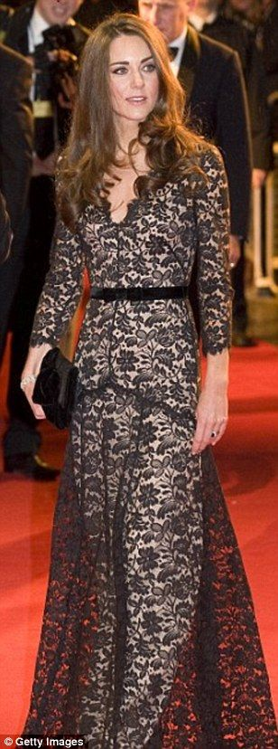 First time round: Last night's show isn't the first time Kate has chosen floor-length lace...