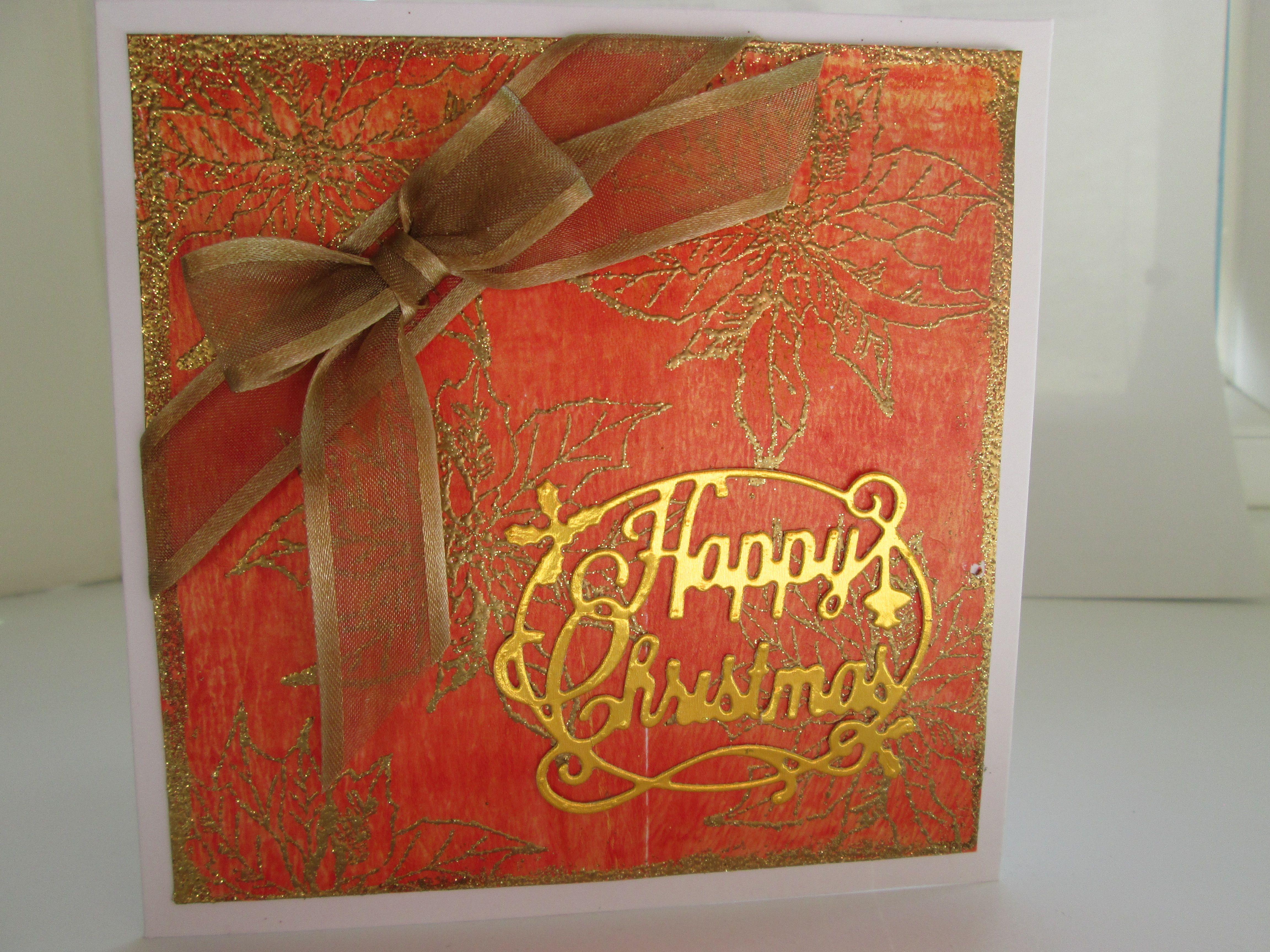 Gelliboard and heat embossed background with die cut greeting Christmas card