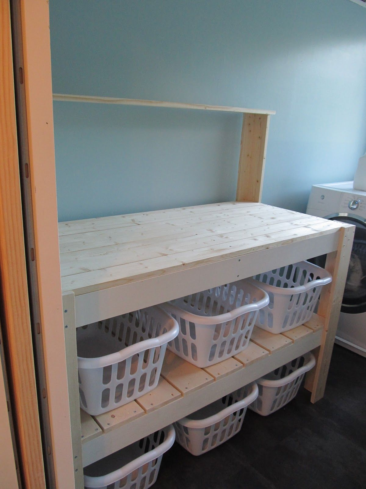 I made this laundry sorter based upon a potting bench DIY plan I