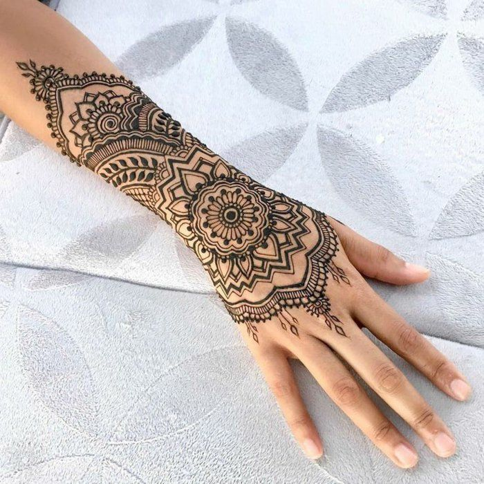 Henna tattoo in black color, arm and wrist tattoo with floral motifs | Body Art