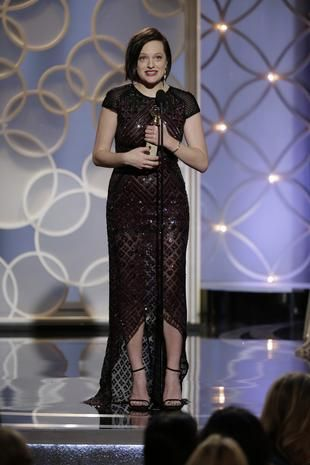 """Elisabeth Moss accepts the award for Best Actress - Mini-Series or TV Movie for """"Top of the Lake"""" during the 71st annual Golden Globe Awards..."""