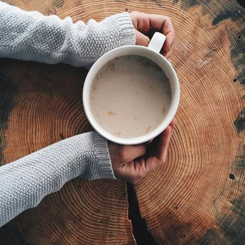 Bundled Up With A Big Cozy Knitted Sweater A Big Cup Of Coffee