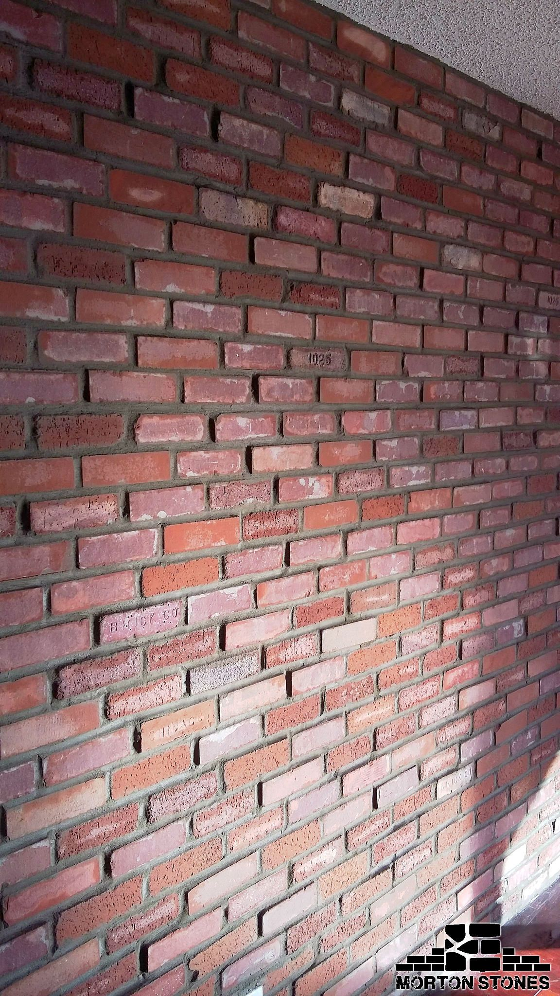 Installing red brick veneers in Miami. #mortonstones #brick #tiles ...