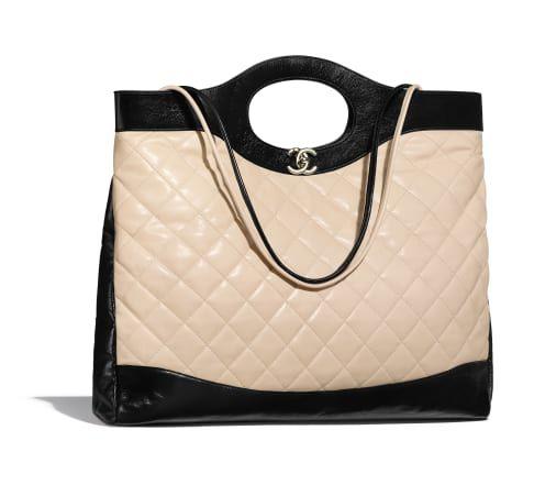 396ea23e513c CHANEL 31 Large Shopping Bag, aged calfskin, calfskin & gold-tone metal,  beige & black - CHANEL
