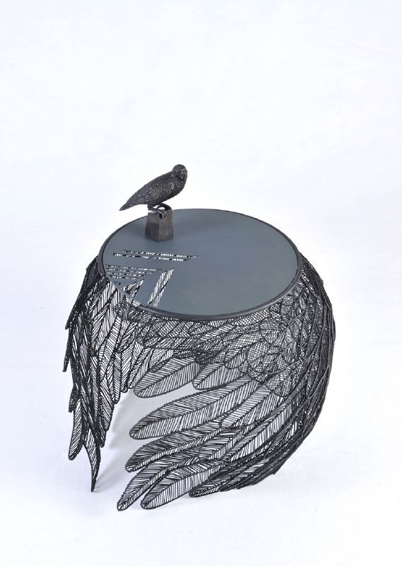 apiwat chitapanya welds stainless steel feathers to create table collection