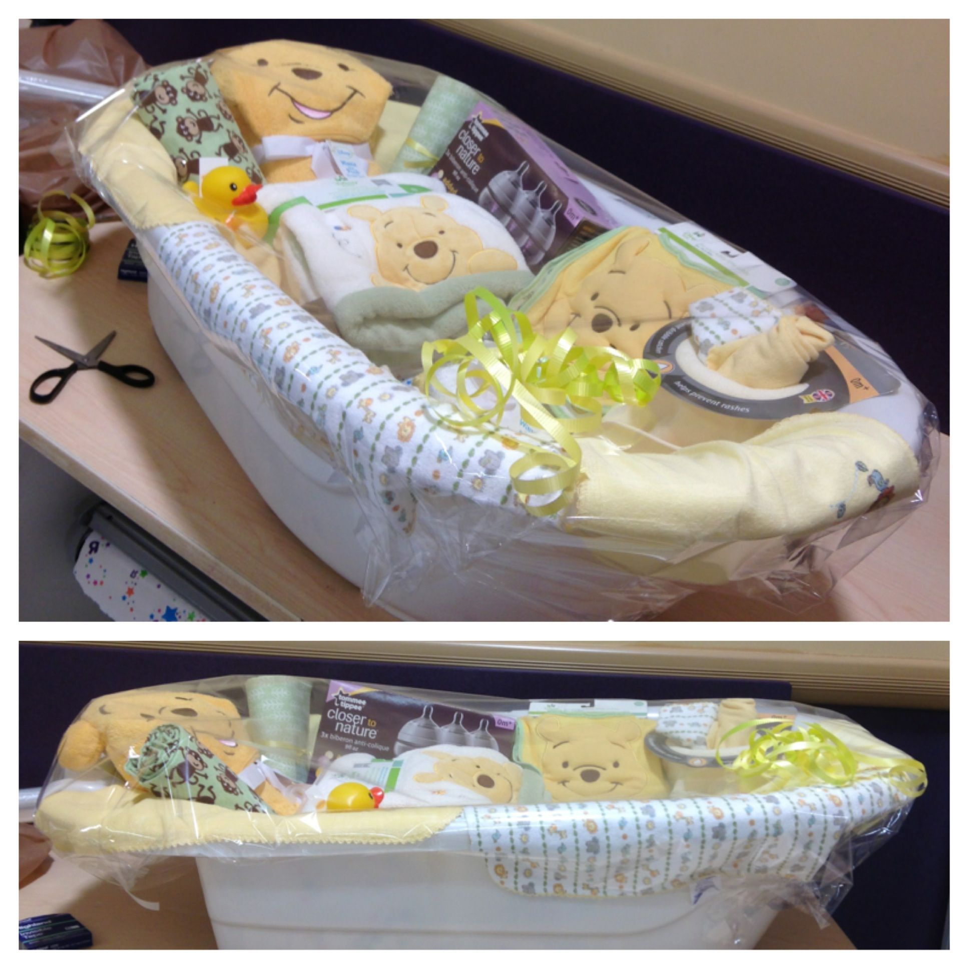 Baby shower t basket used bath tub as a base filled with