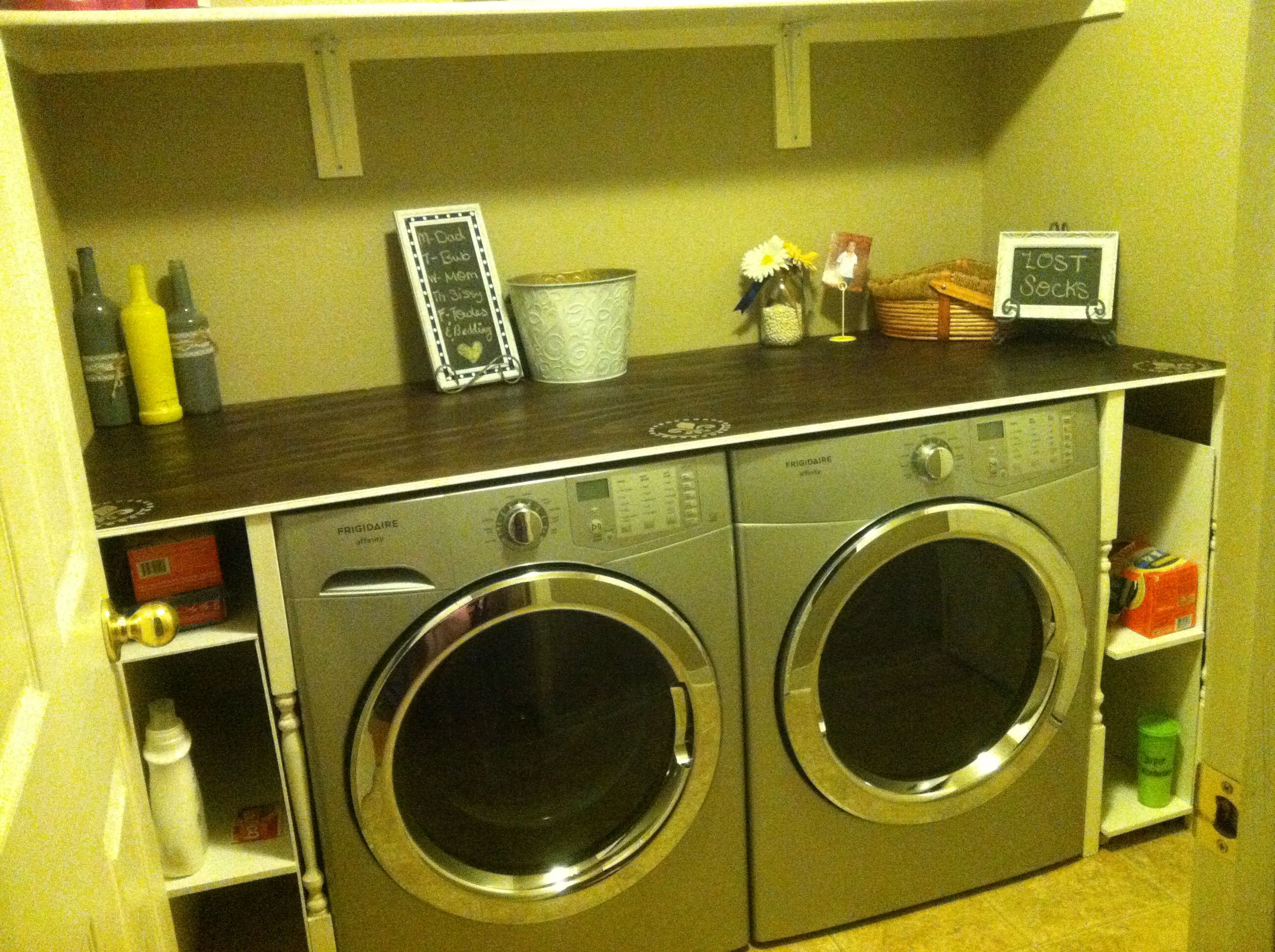 Laundry room folding table with built in rolling shelfs on the