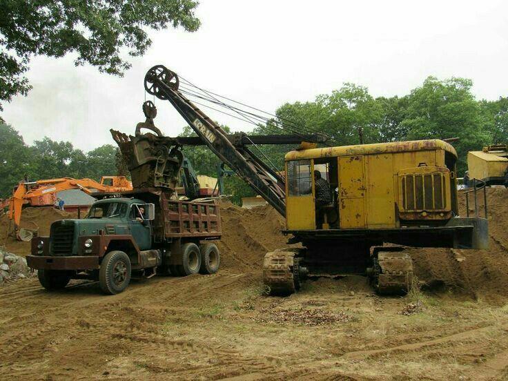 Lorain shovel loading an IH dump truck. Heavy equipment