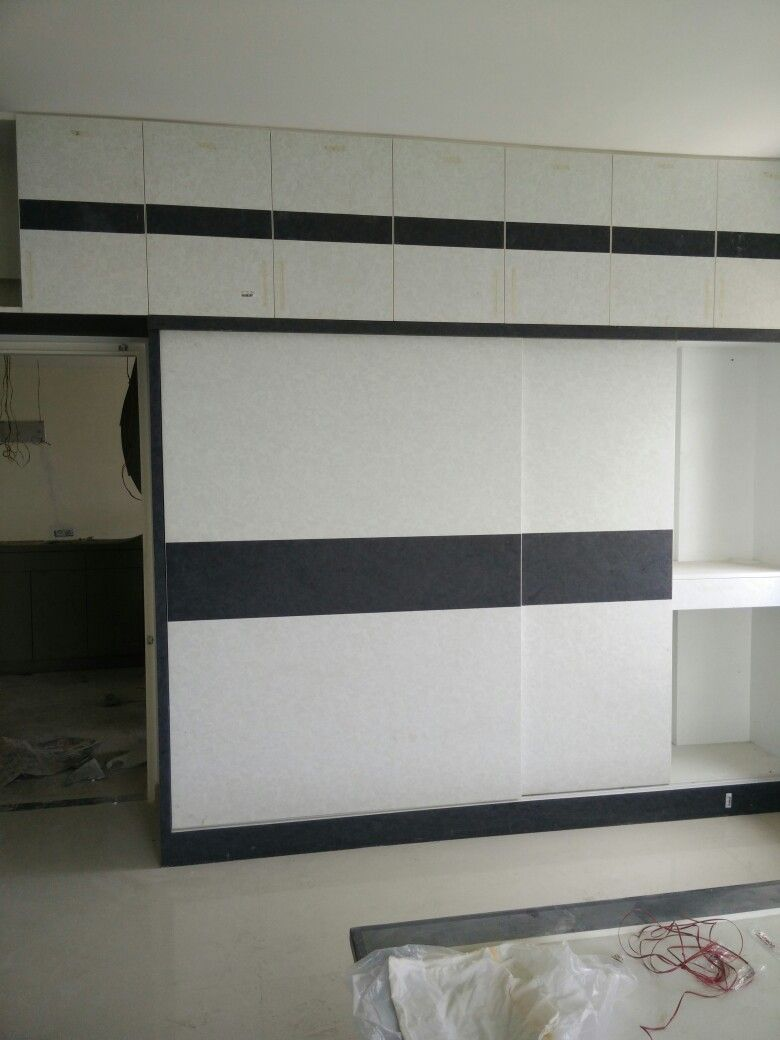 Wardrobe designs for bedroom indian laminate sheets - Sliding Doors Wardrobe With Leather Finish Laminates