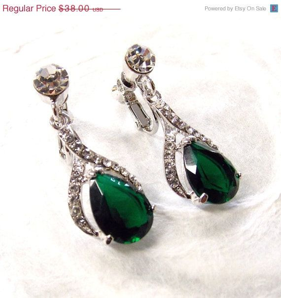 This sparkly design features stunning prong-set cubic zirconia center stones bordered by pave set clear Swarovski crystals. These earrings can be made as