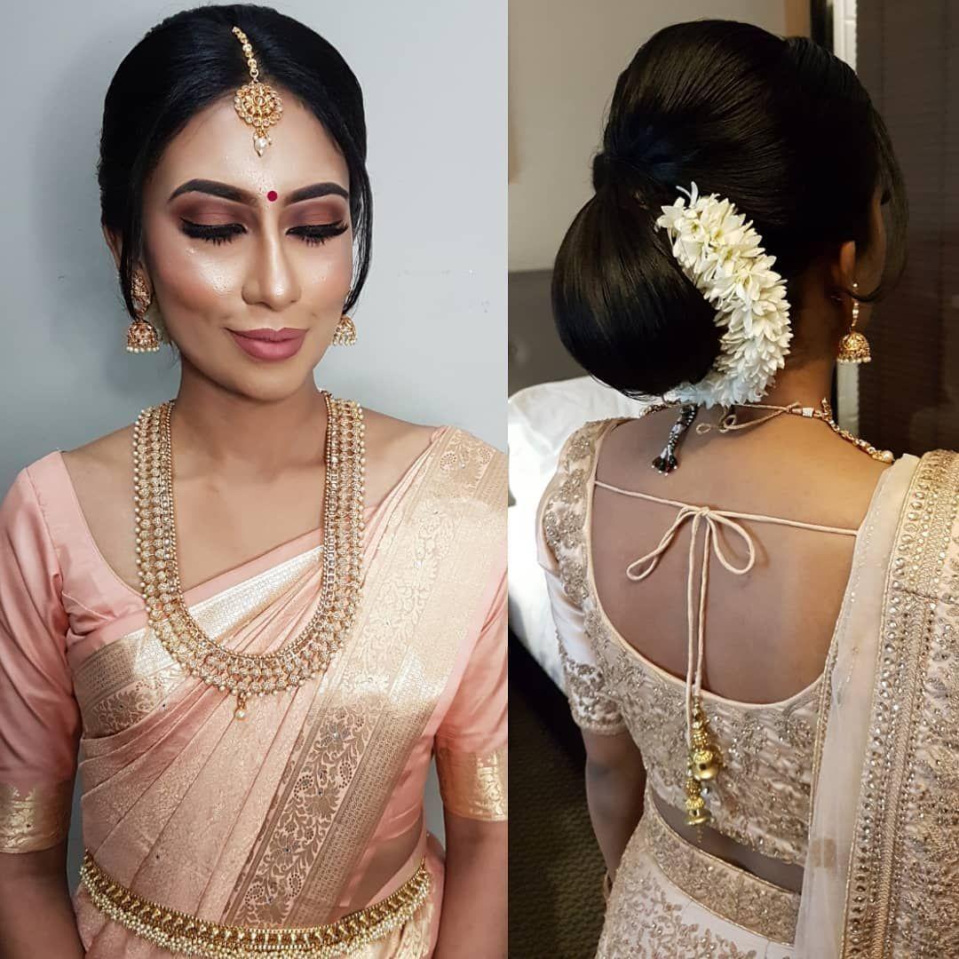 Pale Pink Saree Subtle Finish Makeup Sleek Chignon Bun Hairstyle With White Flowers Beautiful Rijam Indian Bun Hairstyles Saree Hairstyles Bridal Hairdo